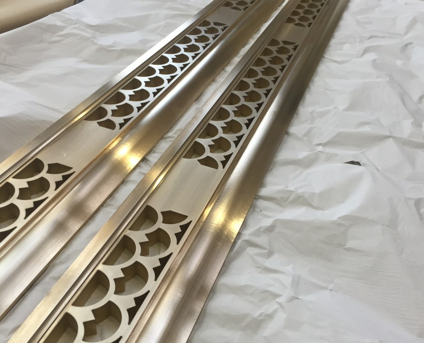 Image of brass skirting board cut by waterjet